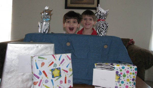 Twins Goofing Around With Birthday Presents